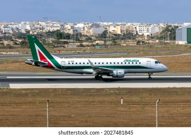 Luqa, Malta - August 17, 2021: Alitalia CityLiner Embraer 175STD (ERJ-170-200STD) (Reg.: EI-RDE) arriving from Rome Fiumicino.