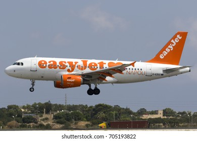 """Luqa, Malta - August 29, 2017: EasyJet Airline Airbus A319-111 [REG: G-EZEZ] in special """"Love Napoli"""" colors landing runway 31 at around mid-day."""