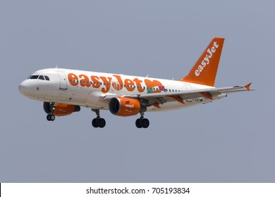 "Luqa, Malta - August 29, 2017: EasyJet Airline Airbus A319-111 [REG: G-EZEZ] in special ""Love Napoli"" colors landing runway 31 at around mid-day."