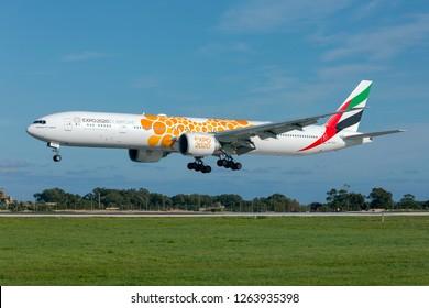 Luqa, Malta - December 21, 2018: Emirates Boeing 777-31H/ER (REG: A6-ECU) with special Expo 2020 logo landing runway 31.