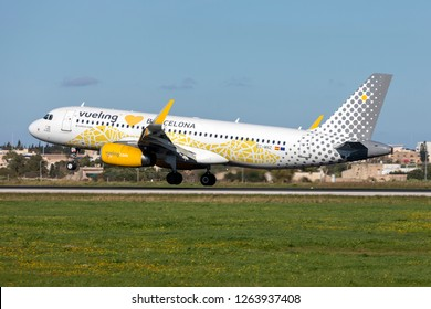 Luqa, Malta - December 21, 2018: Vueling Airlines Airbus A320-232 (Reg: EC-MNZ) with special livery landing runway 31.
