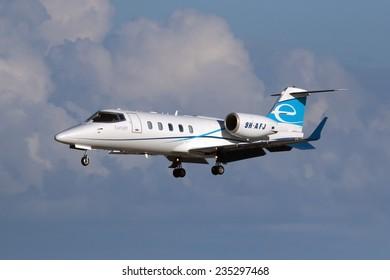 Luqa, Malta December 4, 2014: Eurojet Learjet 60 landing down runway 31.