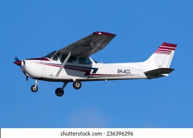 Luqa, Malta December 8, 2014: Malta School of Flying Cessna 172M Skyhawk landing runway 31 during a pilot training session.