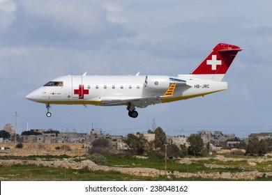 Luqa, Malta February 17, 2005: REGA - Swiss Air Ambulance Bombardier Challenger 604 (CL-600-2B16) landing runway 32.