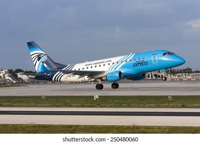 Luqa, Malta January 18, 2009: Egyptair Express Embraer 170LR (ERJ-170-100LR) (SU-GDF) departs runway 14 back to Cairo, Egypt.