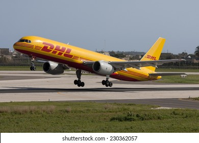 Luqa, Malta January 20, 2011: DHL (European Air Transport - EAT) Boeing 757-236(SF) lifting off runway 31.