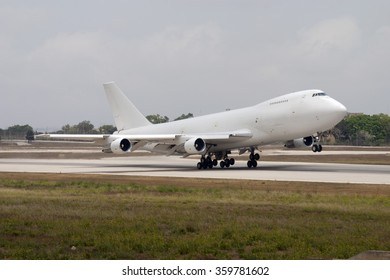 Luqa, Malta June 15, 2005: All white Dubai Air Wing Boeing 747-2B4BM(SF) [A6-GDP] taking off from runway 14.