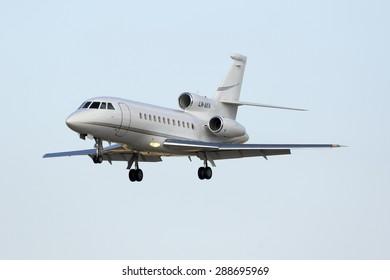 Luqa, Malta June 19, 2015: A private Dassault Falcon 900EX (LN-AKR) on short finals runway 31.