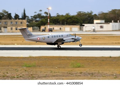 Luqa, Malta June 21, 2016: Malta Air Force Hawker Beechcraft 200/250 King Air (C-12) [AS1126] departing after sunset for a SAR mission.