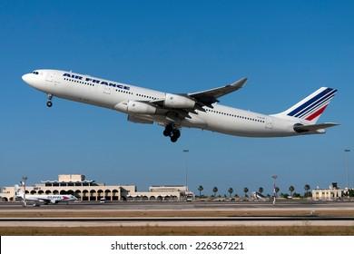 Luqa, Malta, June 29, 2011: An Air France A340 departs Malta after having been serviced at Lufthansa Technik Malta (LTM).
