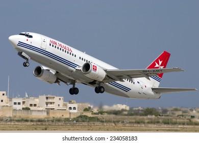 Luqa, Malta June 6, 2005: Air Malta Boeing 737-3Y5 [9H-ABT] taking off from runway 32.