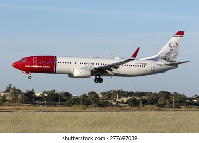 Luqa, Malta May 13, 2015: Norwegian Air Shuttle Boeing 737-8JP (LN-NIA) arriving from Oslo, runway 31. Sporting John Ludvig Runeberg, nation poet, color scheme.
