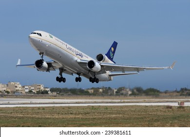 Luqa, Malta May 30, 2008: Saudi Arabian Airlines Cargo McDonnell Douglas MD-11F takes off from runway 31.