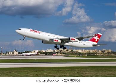Luqa, Malta November 10, 2004: Swiss International Air Lines Airbus A340-313 on pilot training flights in Malta.