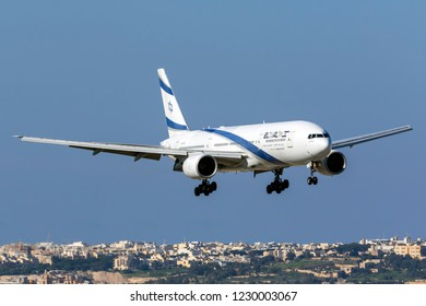 Luqa, Malta - November 13, 2018: El Al Israel Airlines Boeing 777-258/ER (REG: 4X-ECB) landing runway 13, arriving for painting works at ACM Malta.