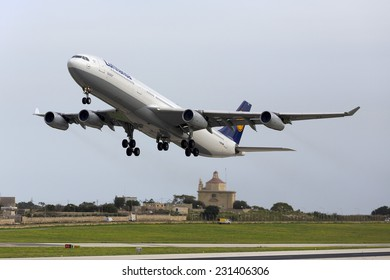 Luqa, Malta November 18, 2014: Lufthansa Airbus A340-313 departing Malta after servicing at Luthansa Technik Malta (LTM).