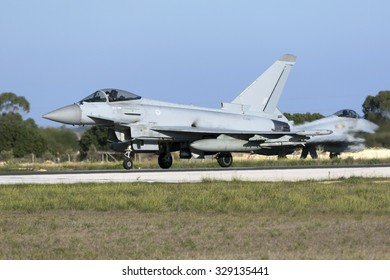 Luqa, Malta October 19, 2015: 2 Royal Air Force Eurofighter EF-2000 Typhoon FGR4 taxiing on the runway after arriving with another 2 Eurofighters.