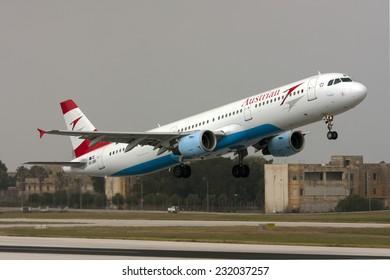 Luqa, Malta October 4, 2009: Austrian Airlines (Tyrolean Airways) Airbus A321-111 take off runway 31.