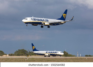 Luqa, Malta - September 2, 2019: Ryanair Boeing 737-8AS (REG: EI-DWI) coming in to land while another Ryanair 737 (EI-DHG) waits on Alpha loop for take off.