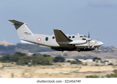Luqa, Malta September 28, 2015: Malta Armed Forces Hawker Beechcraft B200 King Air performing a low pass after having participated in the Airshow during the previous weekend.