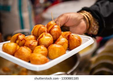 Luqaimat / Lugaimat: traditional dessert in the Middle East, deep fried dumplings, therefore, honey, regular syrup, or date syrup must be poured on top of the dumplings.