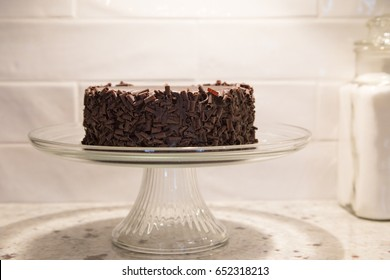 luscious gluten free chocolate cake on a vintage footed glass plate