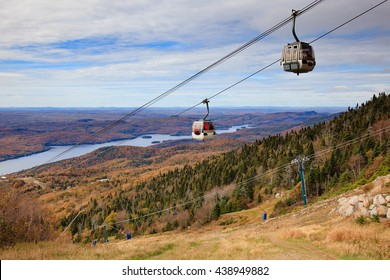 Lush boreal forest panorama view from the top of Mont Tremblan (trembling mountain), Laurentian mountains. Panoramic gondola cableway.