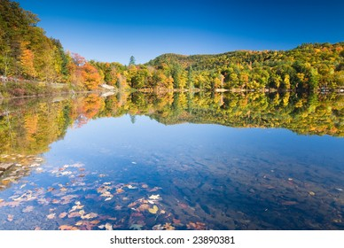 Lush fall foliage reflecting in an amazingly smooth lake