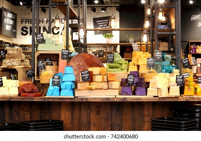 "Lush Fresh Handmade Cosmetic's organic,colorful soap bars on display, selling natural hair and beauty products.The company's motto:""If it's naked, it's fresh"". Union Street,Bath,England.09/09/2017."