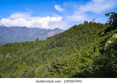 Lush green forest. Hindu temple on the top of hill.The temple is at a height of 1,000 feet above the plain and overlooks the city of Srinagar. Shankaracharya temple is hindu temple.