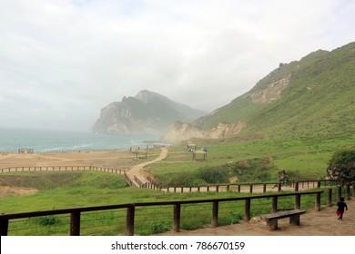 Lush green landscape and Seascape, Al Mughsayl Rocky Beach, Salalah, Oman