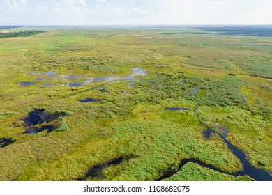 Lush, green Linyanti floodplain with lagoons and channels photographed from helicopter.