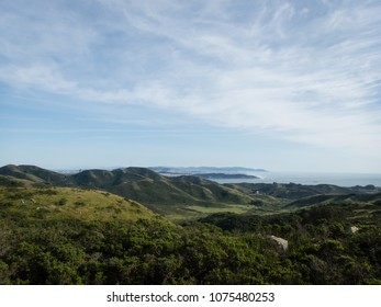 Lush green San Francisco Headlands and bay viewed from mountains