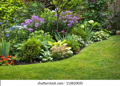 Lush landscaped garden with flowerbed and colorful plants