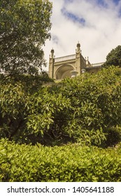 Lush trees and bushes with spring green foliage in the Park at the Vorontsov Palace.Crimea.