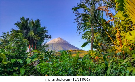 A lush tropical rain forest frames a beautiful Volcano in Arenal, Costa Rica.