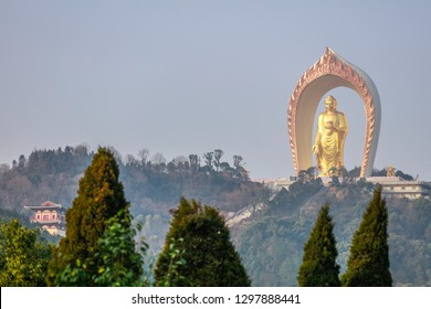 LUSHAN CHINA-January 24, 2019: Tourists visit the newly built Pure Land Garden of Linsi in Lushan, the world's tallest statue of Amitabha Buddha. All construction funds come from donations.