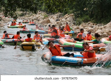 LUSHAN CHINA-July 4, 2013: many tourists in Jiangxi Mount Lu Longtan Bi stone canyon rafting water hot summer glacier. Continuous hot weather, to attract tourists to enjoy the water cool and fun.