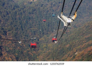 LUSHAN CHINA-November 1, 2018: tourists take the Mount Lu on the traffic ropeway. The world's most advanced super large cableway technology is the first 3S cableway built in Asia and China.