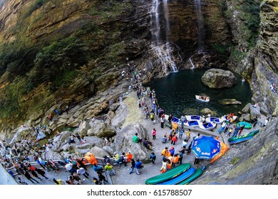 LUSHAN CHINA-October 6, 2014:summer and autumn, tourists in Mount Lu scenic area close to the fun of the waterfall. Mount Lu is a famous mountain and natural and cultural heritage of the world.