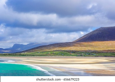 Luskentyre on the Isle of Harris, Scotland, a stormy day with clouds in the sky, outgoing tide from a sandy beach