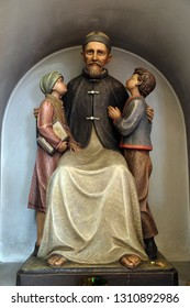 LUSON, ITALY - JULY 14, 2018: Josef Freinademetz missionary in China sculpted by Leonhard Delago of Bula in the Saint George church in Luson, Italy