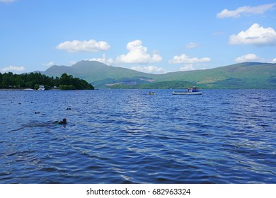 LUSS, SCOTLAND -18 JUL 2017- The banks of Loch Lomond in Luss, a historic village  in Argyll and Bute, Scotland. It is a popular tourist destination for day trippers from Glasgow.