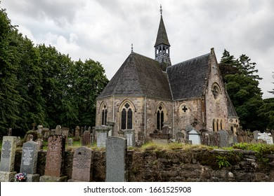 LUSS, SCOTLAND - AUGUST 1, 2019: Luss Parish Church dedicated to Saint Kessog with a graveyard in front of it