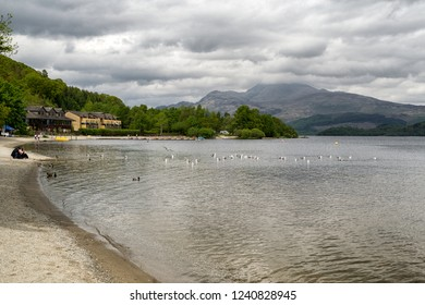 LUSS, SCOTLAND - MAY 21: Beach on lake Loch Lomond in village Luss on May 21, 2018 in Luss