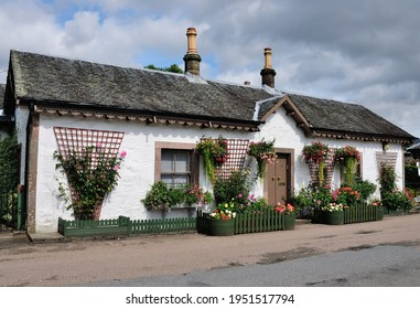 Luss, UK - August 23, 2019 - Picturesque cottage in Luss village in Argyll and Bute, Scotland, on the west bank of Loch Lomond