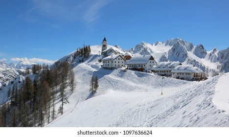 Lussari Mountain Tarvisio, UD, Italy - April 1, 2018: fabulousness panorama of the ancient Sanctuary with snow and more buildings