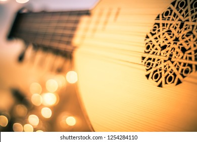 Lute with instrumental sheet music and soft lights for Christmas holiday, split tone