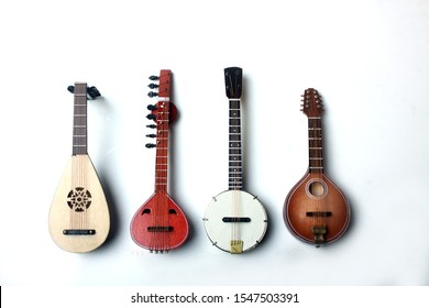 lute, mandoline, banjo and sitar isolated on white background