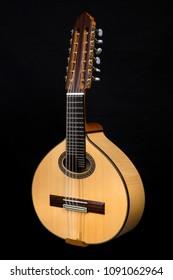 Lute on black background. Lute, mandolin, bandurria.